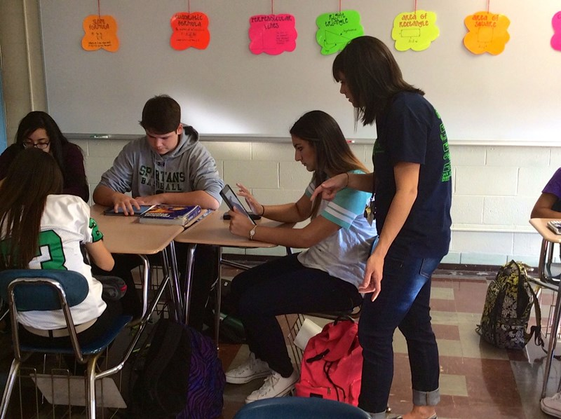 Mrs. Strelow assists students in her Geometry class